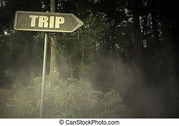 old signboard with text trip near the sinister forest -...