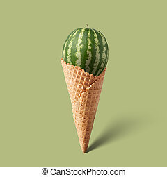 Waffle cornet with watermelon isolated on green