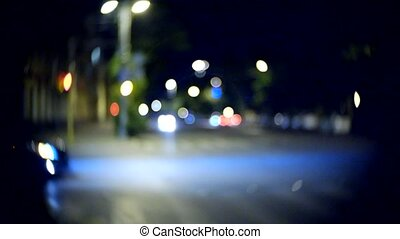 Moving car with blur light through city at night - Moving...
