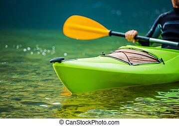 Kayaker on the River - Caucasian Kayaker on the River...