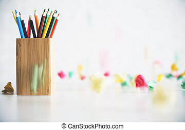 Pencil holder on messy desk - Close up of wooden pencil...