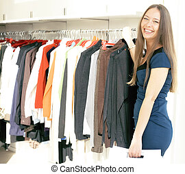 young pretty woman shopping at mall smiling adorable...