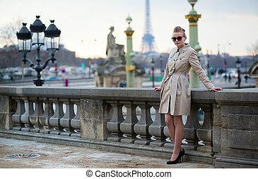 Beautiful young Parisian woman outdoors