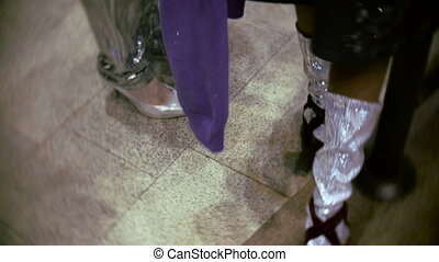 Foot two models waiting for the show at the backstage of...