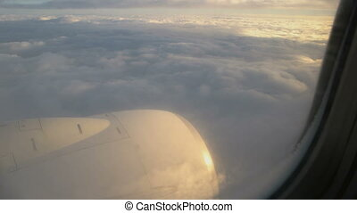 Traveling by air. View through an airplane window - Clouds...