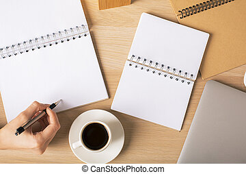 Female writing in notepad - Top view of female's hand...