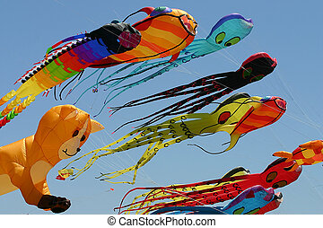 Kites - A couple of colorful kites flying in blue sky in San...