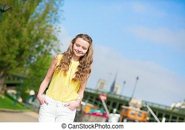 Joyful girl walking in Paris