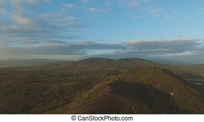Crossroad Traffic From Above Mountines - Aerial timelapse of...