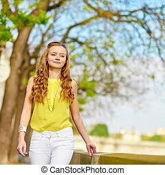 Beautiful young girl walking in Paris