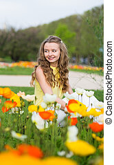 Girl with beautiful colorful poppies