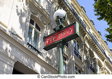 Traditional metro sign with old, historical building in the...