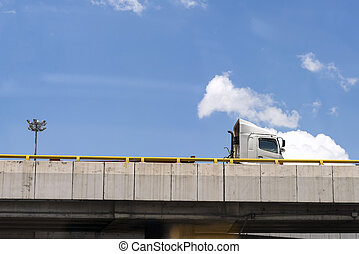 The transportation  truck on the bridge after shipping at cargo.
