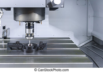 The measurement probe on the CNC machine for calibration.The...