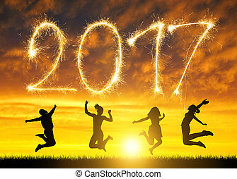 Girls jumps up in celebration of the New Year 2017. - Girls...