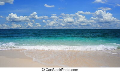 Tropical beach stock footage - Clouds moving fast over the...