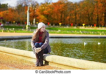 Girl enjoying fall day in Paris