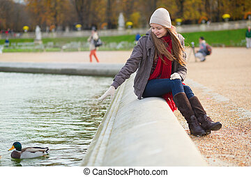 Girl enjoying sunny spring day in Paris