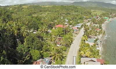Philippine village near the coast. - Philippine village near...
