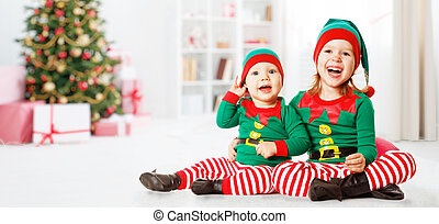 Christmas concept two happy cheerful child  elf