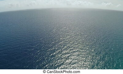Flight over the ocean. Aerial views.