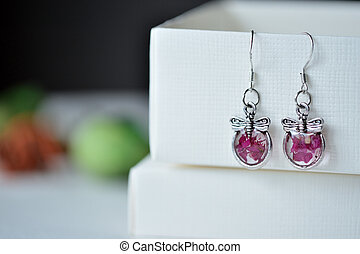 Epoxy resin earrings with rose petals close up