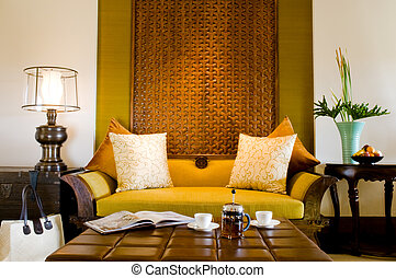 Contemporary living area resort hotel suite room with fruits...