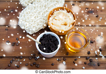 coffee scrub in cup with honey and wisp on wood - beauty,...