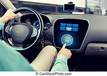 close up of man in car with starter on computer - transport,...