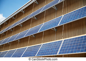 solar battery panels on building facade - energy sources,...