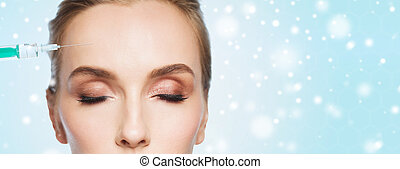 close up of woman face and syringe over snow - people,...