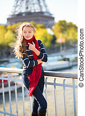 Girl in Paris on a sunny spring or fall day