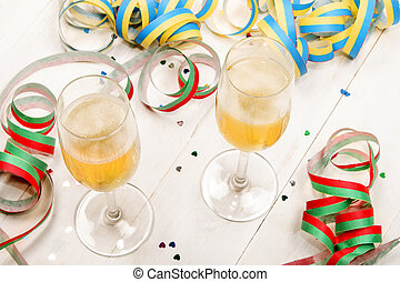 new year 's eve party with two filled champagne glasses,...