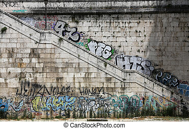 Descent to the Tiber, painted with graffiti. Rome, Italy