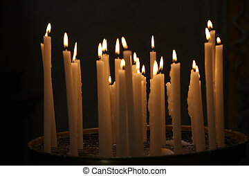 Candles in the dark of a church