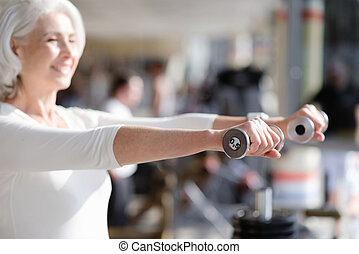 Delighted woman keeping fit. - Exercise with smile. Joyful...