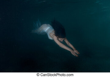 Woman mermaid under water. - Woman mermaid swimming under...