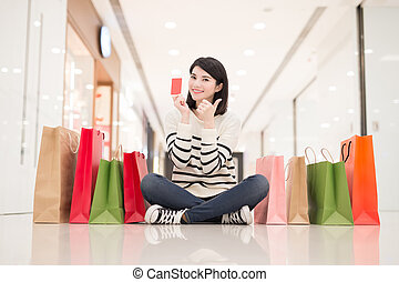 shopping woman show credit card - happy shopping young woman...