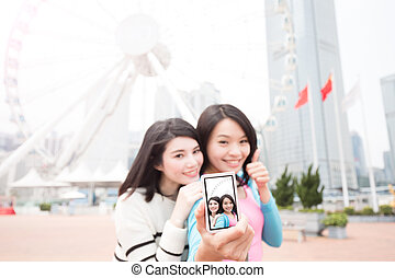 two woman selfie in hongkong - two beauty woman thumb up and...