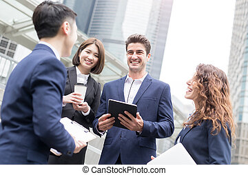 businesspeople meeting on the road in hong kong