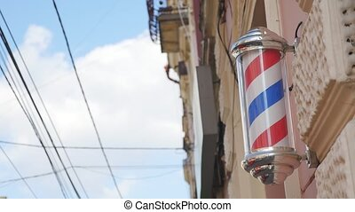 Old barber shop pole on wall