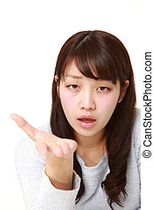 angry woman requests something - studio shot of young...