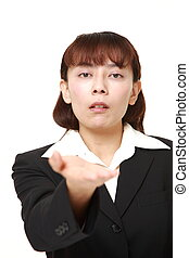 angry businesswoman requests something - studio shot of...