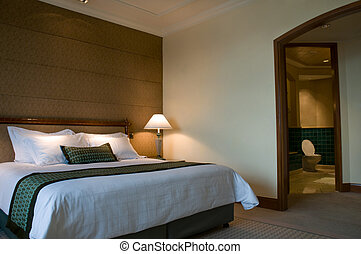 King size bed and bathroom of a five star suite