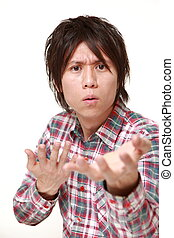 young Japanese man requests something - portrait of young...