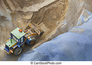 top view of heavy machine working in construction site