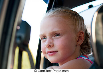 portrait of a girl in the car
