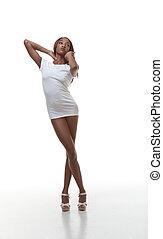 Black naked woman in white t-shirt, slender legs