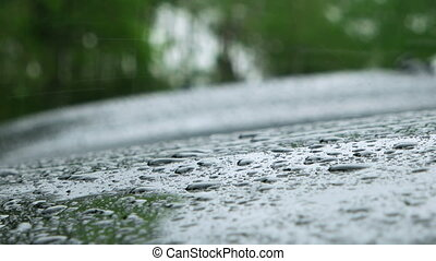 Rain Drops Splashing Onto The Car On A Rainy Day. - Water...
