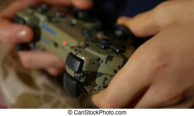 Boy playing game joystick video game console online - Boy...